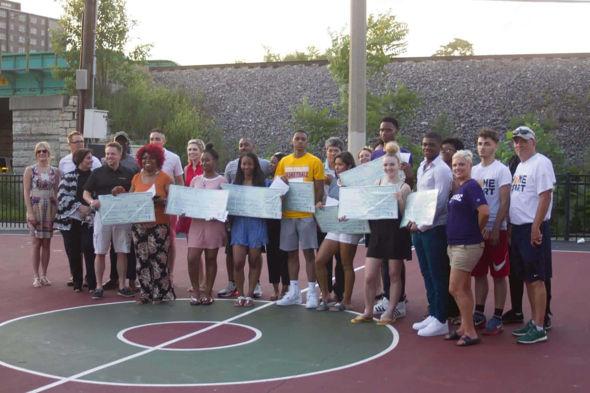 group of high school students receiving scholarships