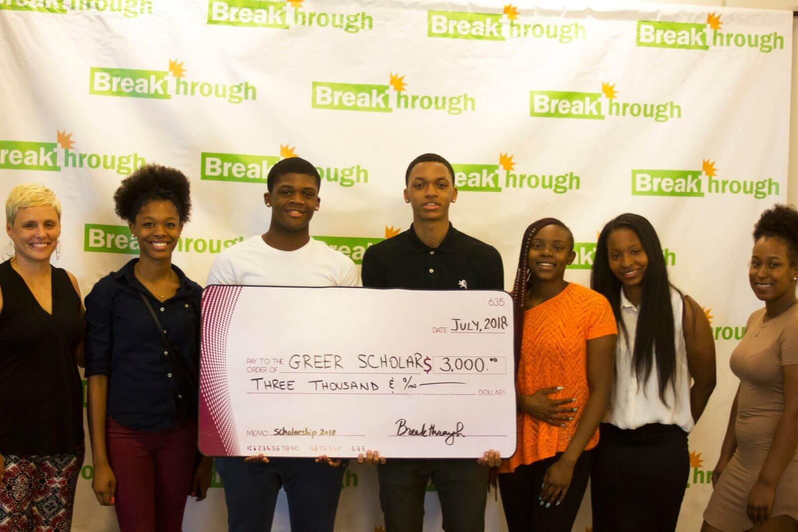 high school students receiving scholarship