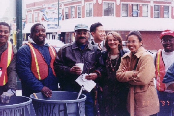 men and women smiling and participating in Cleanstreet program in 1993