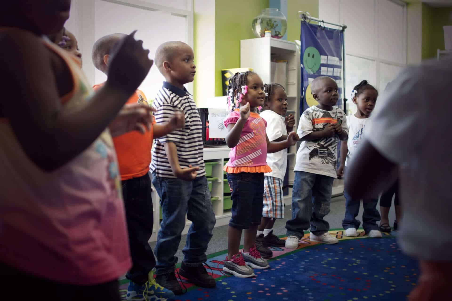 students in a circle doing an activity at Breakthrough Beginners preschool