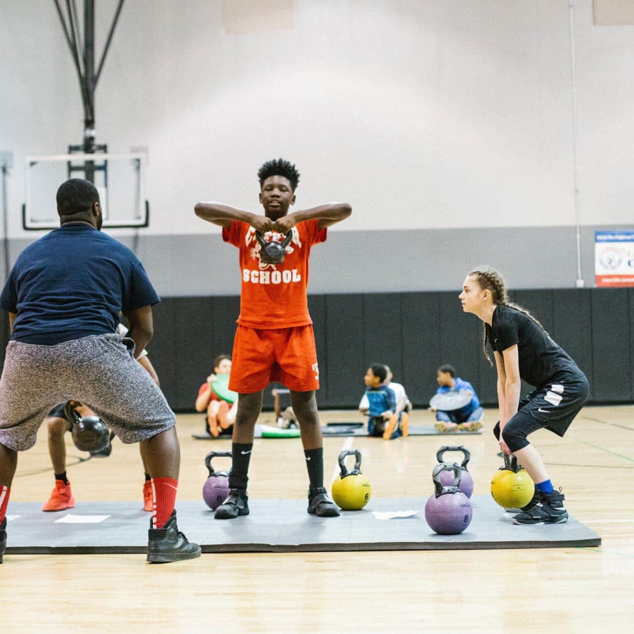 youth working out with kettlebells at Breakthrough FamilyPlex gym