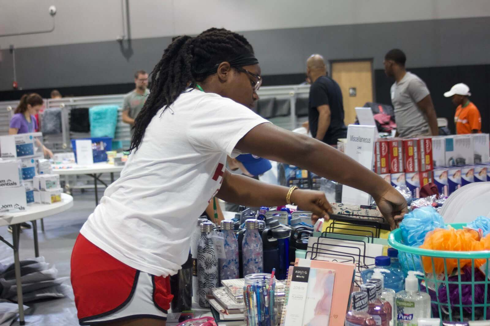 woman organizing supplies at Breakthrough Trunk Party