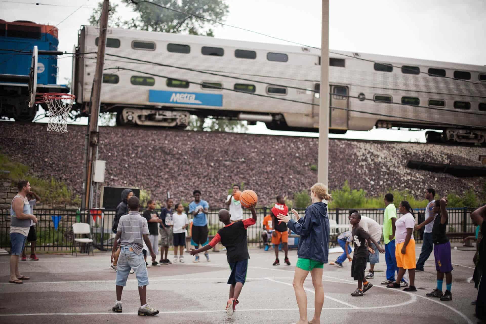 youth playing basketball at neighborhood park