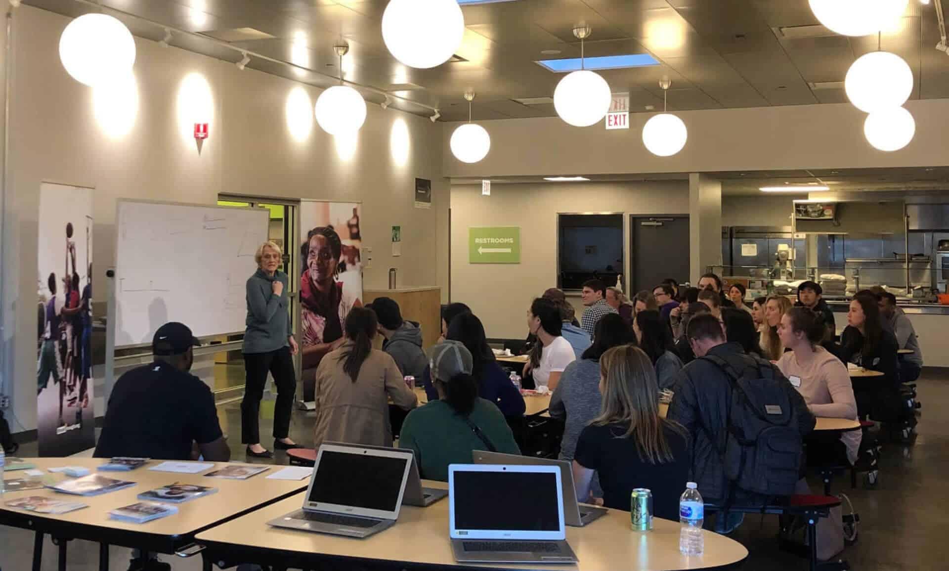 Arloa Sutter speaking to volunteers at Breakthrough FamilyPlex training event