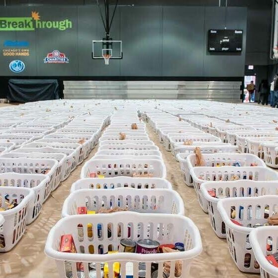 hundreds of baskets of food assembled for Thanksgiving giveaway event