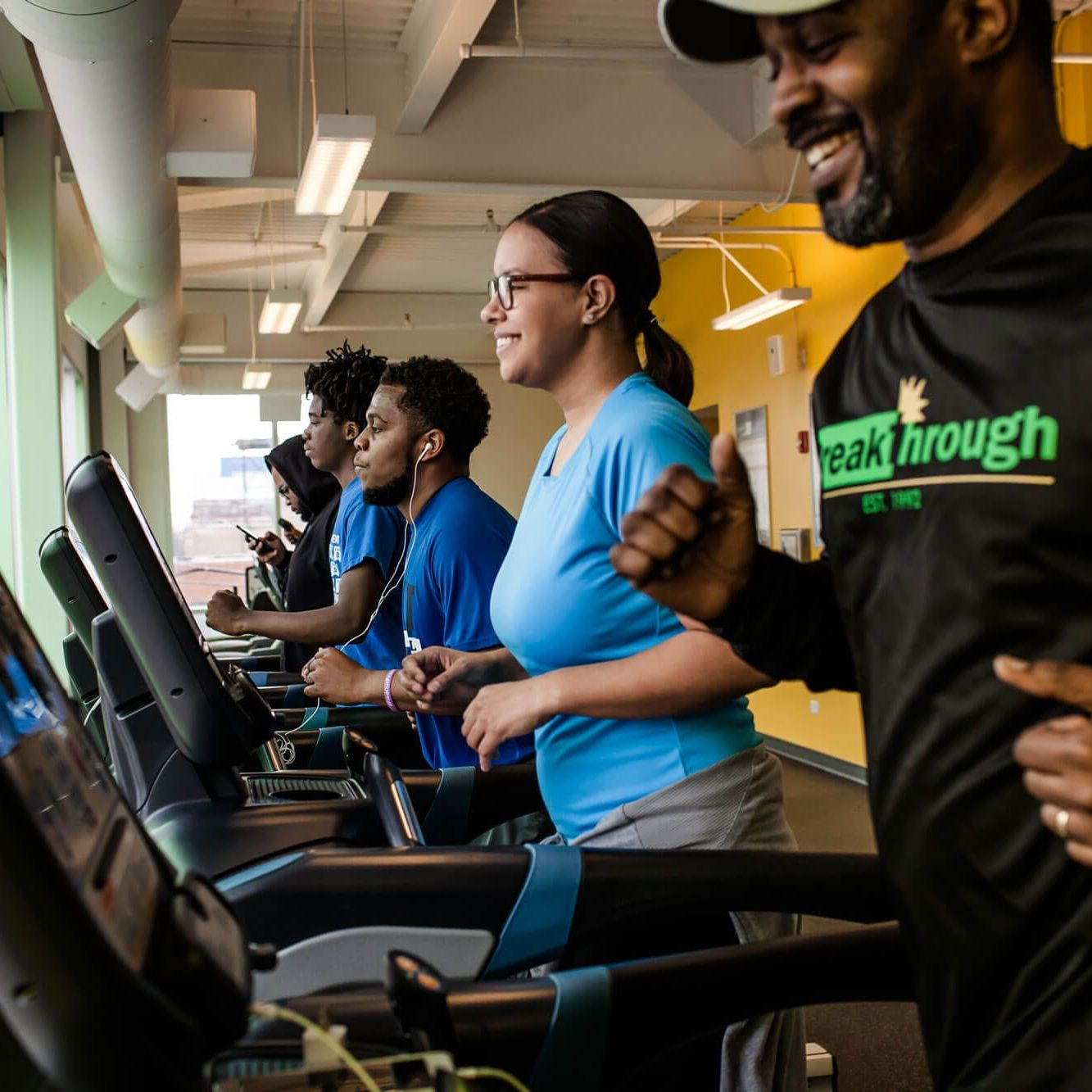 Runners on treadmills at the Breakthrough Fitness Center