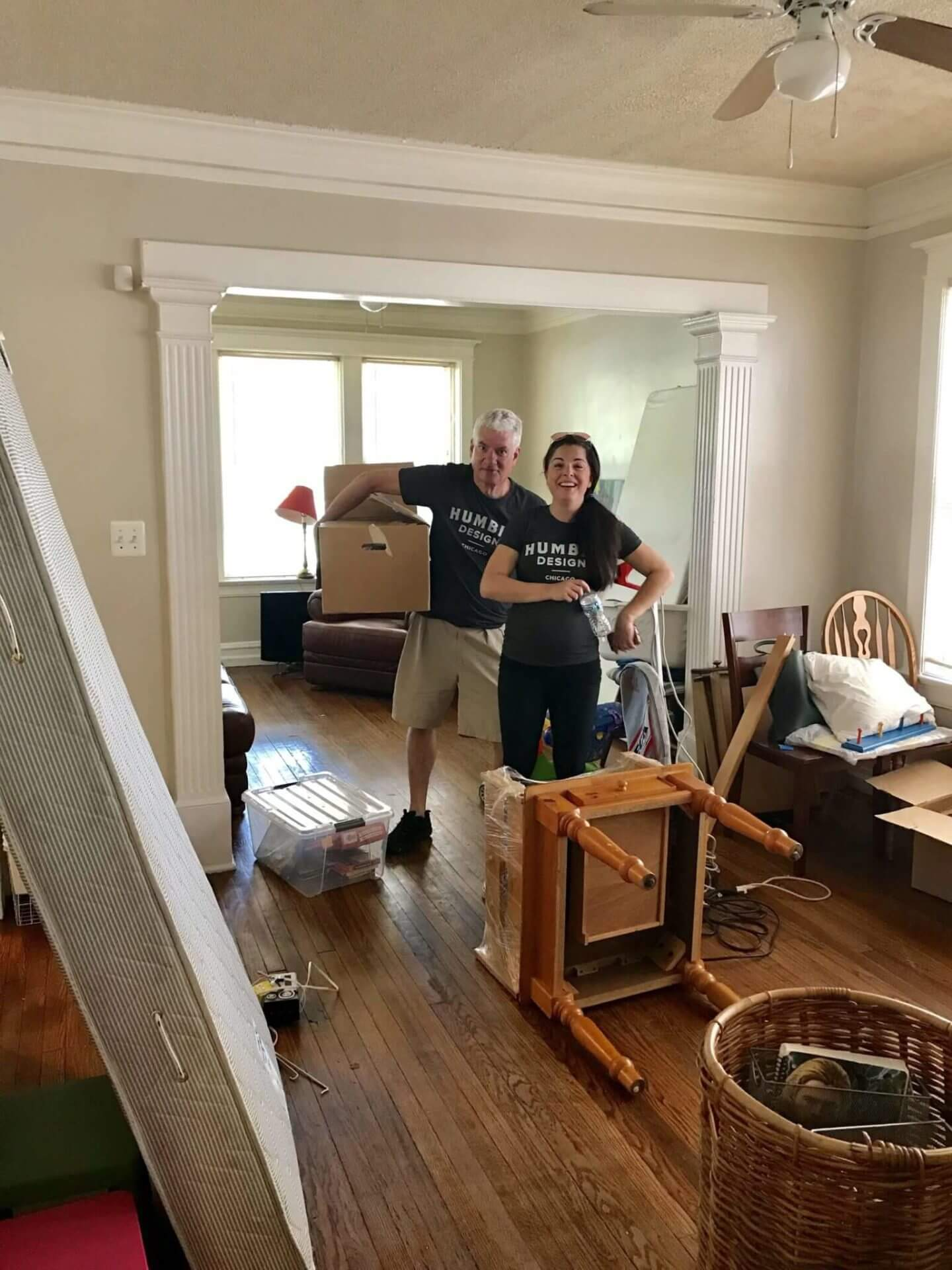 Volunteers moving furniture into new home