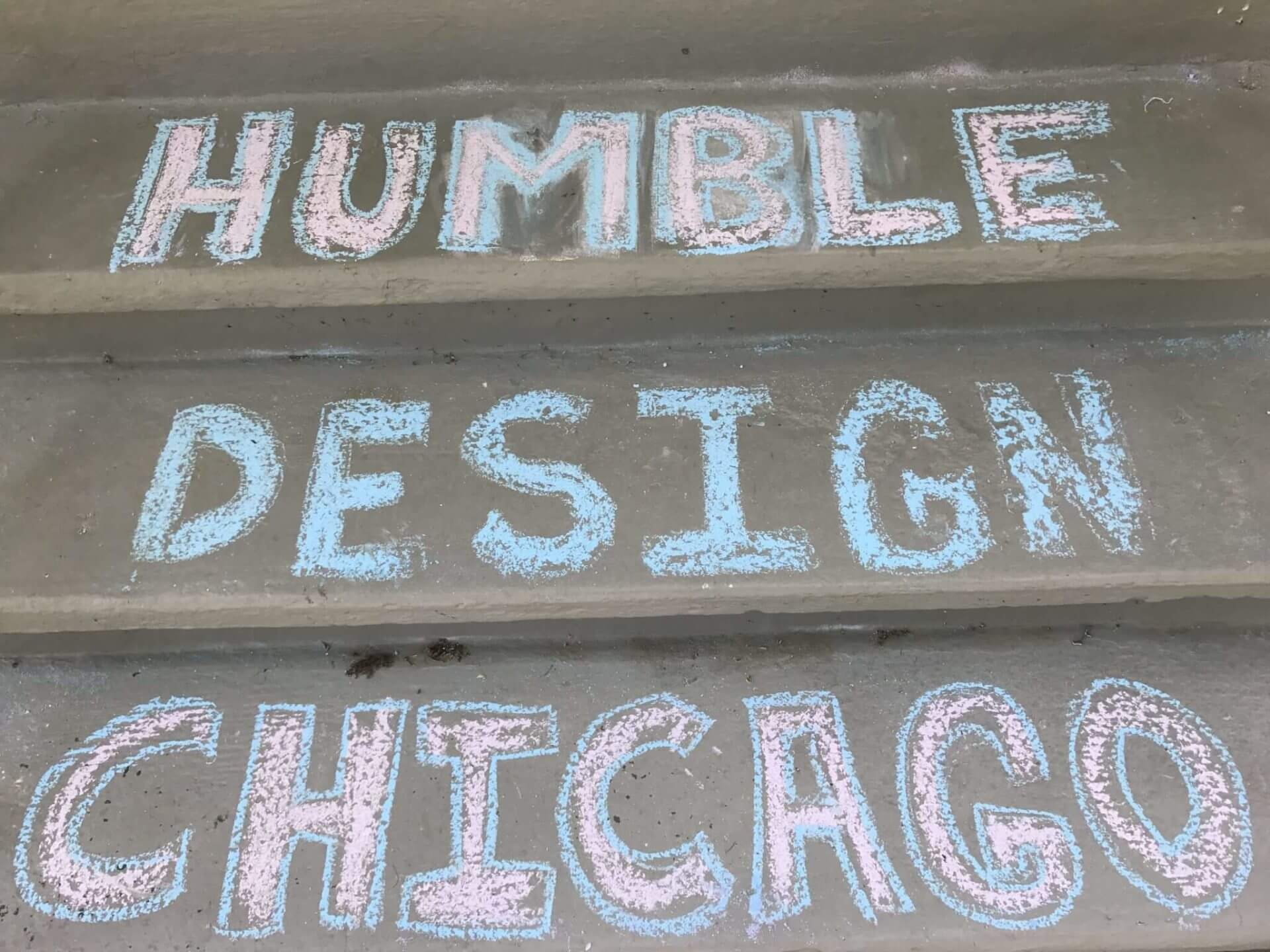 Chalk letters on home front steps