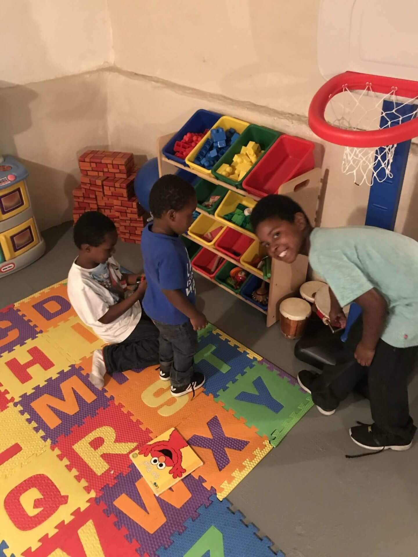 boys playing with toys in new play room