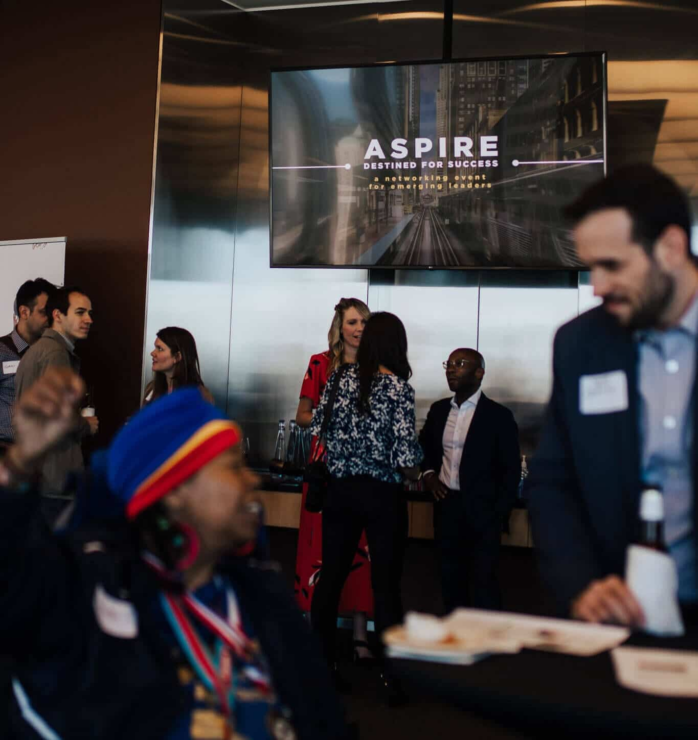 young professionals mingling at business networking event Aspire Breakthrough