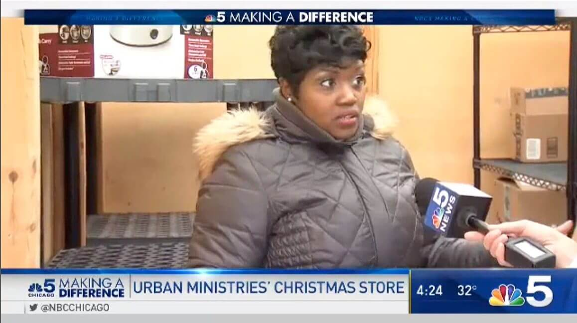 Wilonda Cannon standing in front of shelves for Christmas Store gift drive