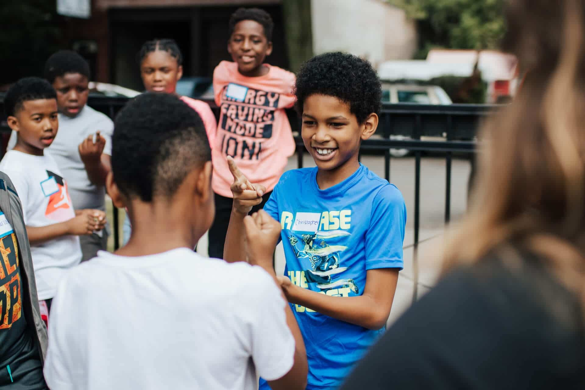 boys playing rock-paper-scissors at youth olympics events in East Garfield Park