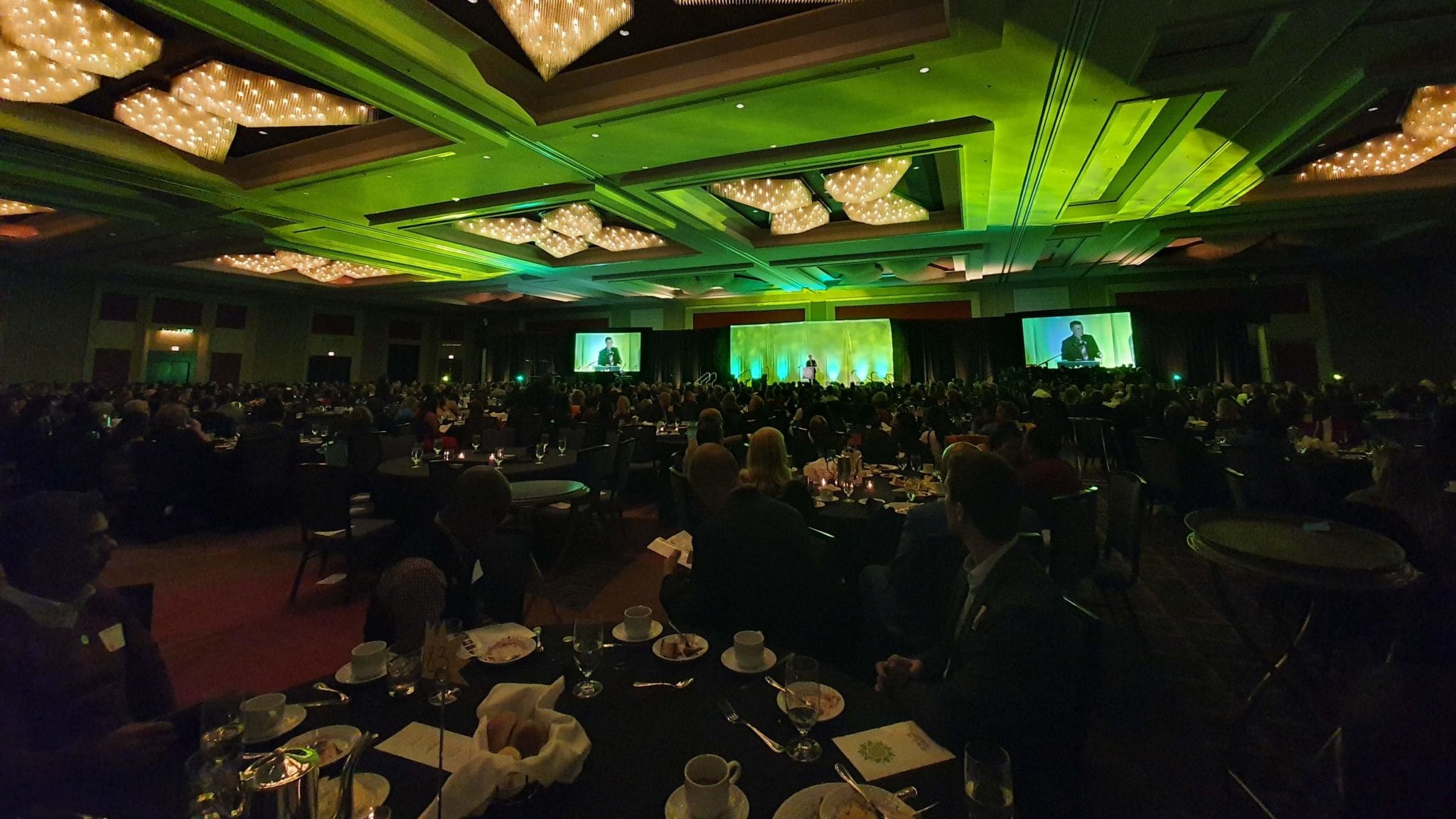 Wide room shot on guests and dining tables from 2019 Breakthrough Annual Benefit