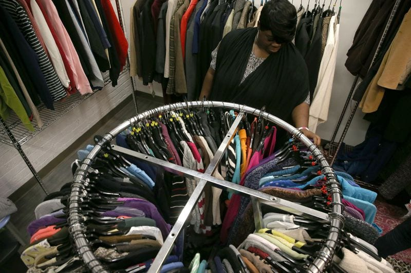 Woman looking through clothes at Breakthrough Women's Boutique donation closet