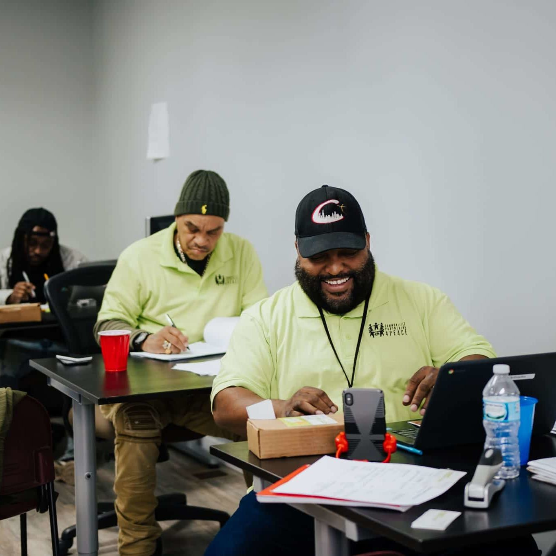 Breakthrough Violence Prevention Center staff working at desks