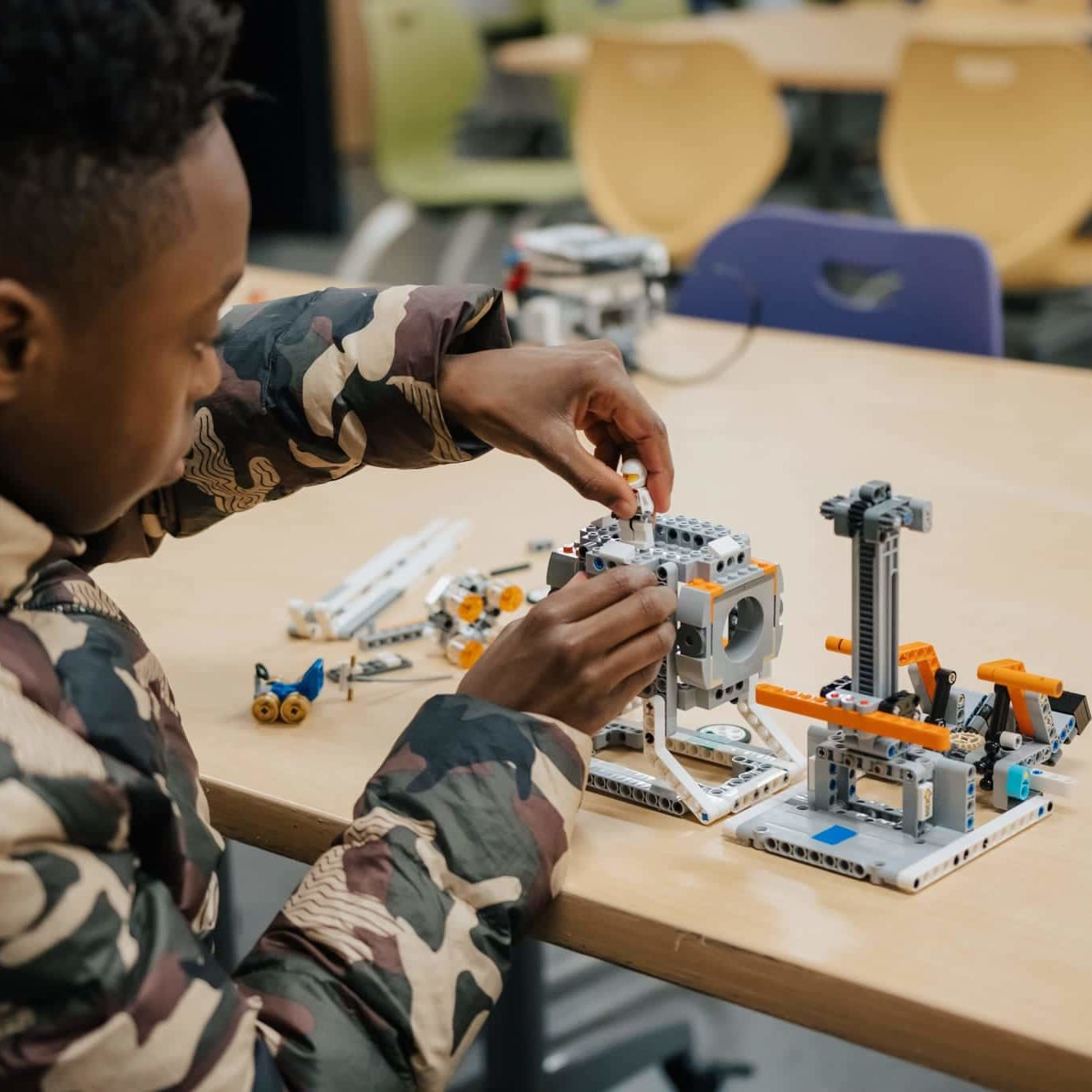 Breakthrough Robotics student designing with legos